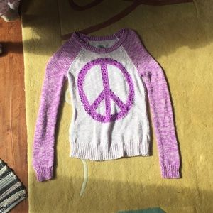 Purple and white sparkly peace sign sweater